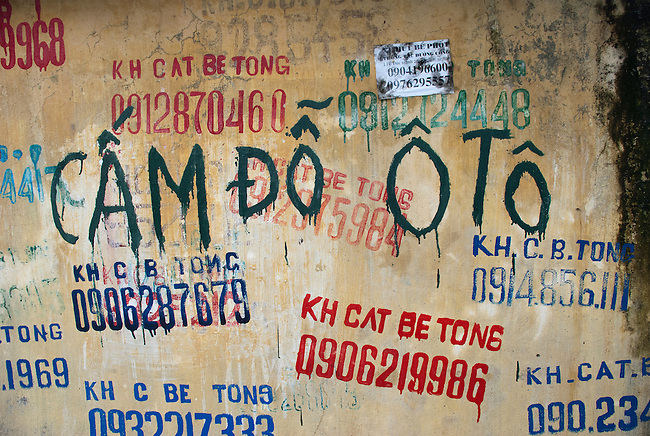 Hanoi, Vietnam, Buildings throughout the city are marked by demolition crews with their telephone numbers requesting their services. photo taken July 2008.