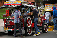 BOGOTA, Colombia. 13th June 2014. People buy a coffee cup in a jeep on a street in Bogota few days before presidential election in Colombia. Photo by Eduardo Munoz Alvarez/VIEWpress