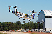 The XV-15 tilt rotor aircraft shows its versitility by pitching its nose down during its final flight at the National Air and Space Museum's new Steven F. Udvar-Hazy Center near Washington Dulles International Airport in Herndon, Virginia on September 16, 2003.  Tilt rotors are a unique type of aircraft that possess the take-off, hover and landing capabilities of a conventional helicopter with the range and speed of a turboprop aircraft.  Tilt rotor flight research began in the 1950s with the Bell XV-3 convertiplane.  NASA's Ames Research Center, Moffett Field, Calif., in partnership with the U.S. Army, developed design specifications for a new aircraft to demonstrate the viability of the tilt rotor concept.  After extensive ground, wind tunnel and simulator tests at Ames, the first of two XV-15s, built by Bell Helicopter Textron, took its maiden flight on May 3, 1977.  The success of the XV-15 has led to the development of the V-22 Osprey and the world's first civil tilt rotor, the nine-passenger Bell Agusta 609, now under development and scheduled for deliveries in 2007.  The National Air and Space Museum, comprised of the Udvar-Hazy Center, which is scheduled to open to the public on December 15, 2003, and the museum's building on the National Mall, .will be the largest air-and-space-museum complex in the world. .Credit: Ron Sachs / CNP