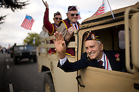 A veteran waves to the crowd during a Veterans Day parade in Elk Grove, CA on November 11, 2007.