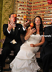 Wedding Photos at Bouley Restaurant in New York City..Whimsical photos with bride and groom juggling apples, hugging, dining, and waltzing on a Manhattan street...