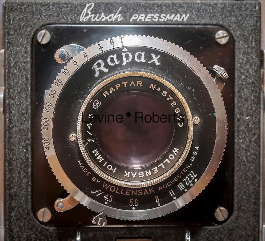 Front standard and lens assembly of a Busch Pressman Model C medium format field camera. Wollensak 101mm f/4.5 Raptar lens in rim set Rapax shutter. . (© Richard B. Levine)