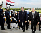 Arlington, VA - July 23, 2009 -- United States Secretary of Defense Robert M. Gates (right) escorts Prime Minister Nouri al-Maliki of Iraq through an honor cordon and into the Pentagon to conduct security talks on Thursday, July 23, 2009. .Mandatory Credit: Robert D. Ward - DoD via CNP