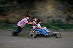 HONDURAS-10010, Children play, La Fortuna, Honduras, 2004.<br />