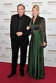Neil Diamond and Katie McNeil arrive for the formal Artist's Dinner honoring the recipients of the 2011 Kennedy Center Honors hosted by United States Secretary of State Hillary Rodham Clinton at the U.S. Department of State in Washington, D.C. on Saturday, December 3, 2011. The 2011 honorees are actress Meryl Streep, singer Neil Diamond, actress Barbara Cook, musician Yo-Yo Ma, and musician Sonny Rollins..Credit: Ron Sachs / CNP