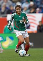 Christine Nieva runs upfield. USA women's national team defeated Mexico 5-0 at Gillette Stadium in Foxborough MA on April 14, 2007
