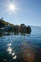 """Boulders on Lake Tahoe 25"" - These boulders and sunburst were photographed near Speedboat Beach, Lake Tahoe."