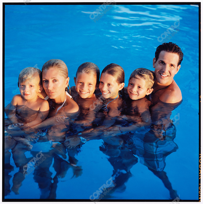 Prince Pavlos, the Crown Prince of Greece, with his wife, Princess Marie-Chantal, and children: (from left) Odysseas, Constantine, Olympia, and Achileas, photographed at their rented villa during their family vacation in Porto Heli. Greece, August 2007.