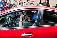 17/08/2012, Moscow, Russia..Protesters play Pussy Riot music from a car outside the court as Maria Alyokhina, Yekaterina Samutsevich and Nadezhda Tolokonnikova of punk band Pussy Riot are sentenced to two years prison for their performance in the Christ The Saviour Cathedral.