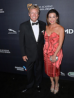 BEVERLY HILLS, CA. October 28, 2016: Nigel Lythgoe &amp; Guest at the 2016 AMD British Academy Britannia Awards at the Beverly Hilton Hotel.<br /> Picture: Paul Smith/Featureflash/SilverHub 0208 004 5359/ 07711 972644 Editors@silverhubmedia.com