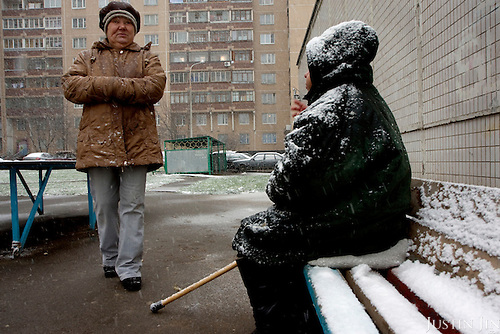 Two women sit in the snow at a housing estate on the outskirts of Moscow. .Picture by Justin Jin.