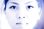Full face portrait of a young Asian woman