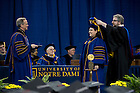 May 19, 2012; Rev. John I. Jenkins, C.S.C., president of the University, hands out doctoral degrees during the Graduate School Commencement Ceremony in the Compton Ice Arena. Photo by Barbara Johnston/University of Notre Dame