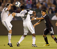 DC United midfielder Andy Najar applies offensive pressure on LA Galaxy defenders Todd Dunivant (l) and Yohance Marshall (r). The LA Galaxy defeated DC United 2-1at Home Depot Center stadium in Carson, California on Saturday September 18, 2010.