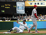 Seattle Mariners' Seth Smith slides into third base after hitting a RBI triple to right field in the third inning of  season home opener April 6, 2015 at Safeco Field in Seattle. Los Angeles Angels third baseman David Freese awaits the throw.  The Mariners beat the Angels 4-1.   ©2015. Jim Bryant Photo. ALL RIGHTS RESERVED.
