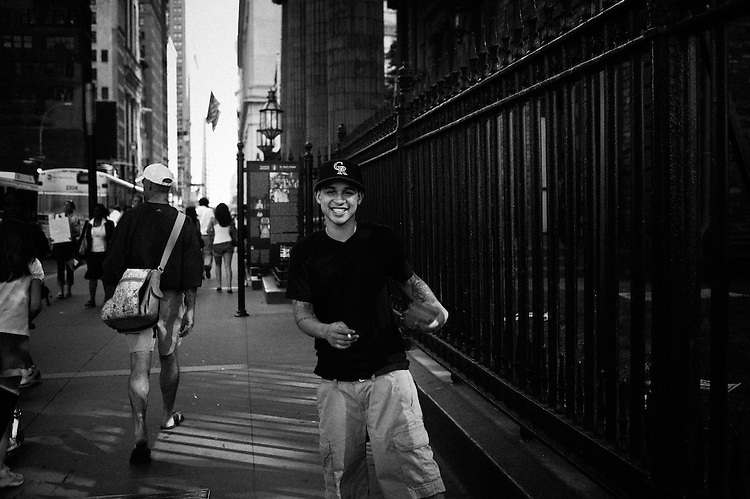 NEW YORK, NY, USA. JUNE 15, 2010. A young guy destributing flyers in front of St. Paul's Chapel. Wandering around Ground Zero while listening to a text Paul Auster recorded for Soundwalk (www.soundwalk.com/#/TOURS/groundzero/). Photo: Antoine Doyen