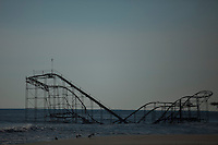 New Jersey, United States. 25th Feb, 2013 -- A Roller coaster is seen onto the sea after almost 4 months of the Sandy Storm disaster at the town of Seaside heights in New Jersey. Photo by Eduardo Munoz Alvarez / VIEWpress.