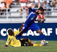 Andre Lewis (11) of Jamaica tries to pull down Arnaldo Alvarado (16) of Honduras during the quarterfinals of the CONCACAF Men's Under 17 Championship at Catherine Hall Stadium in Montego Bay, Jamaica. Jamaica defeated Honduras, 2-1.