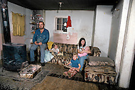 Russellville, Arkansas, U.S.A, December,1980. America severly marked by the recession. Mr Charles Willhong, laid off, and his family do small trades at home and at their front door in order to survive.