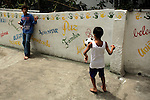 South America, Brazil, Rio de Janiero. Favela kids at play in Vila Canoas.