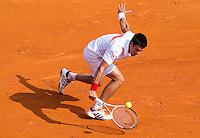 Novak DJOKOVIC (SRB) against David NALBANDIAN (ARG) in the Quarter Finals. Novak Djokovic beat David Nalbandian 6-2 6-3..International Tennis - 2010 ATP World Tour - Masters 1000 - Monte-Carlo Rolex Masters - Monte-Carlo Country Club - Alpes-Maritimes - France..© AMN Images, Barry House, 20-22 Worple Road, London, SW19 4DH.Tel -  + 44 20 8947 0100.Fax - + 44 20 8947 0117