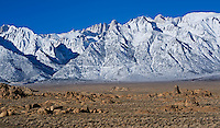 rock formations of Alabama Hills with Mount Whitney and Sierra Nevada mountains in background, California.