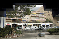 Italy. Lombardy region. Campione d'Italia. Downtown. Town center. Private houses and block of flats. Appartments block. Shops to change money ( Cambio, Euro Change). Campione d'Italia is occupying an enclave within the Swiss canton of Ticino, separated from the rest of Italy. Campione d'Italia takes advantage of its status by operating a famous casino, the Casinò di Campione (on the right side), as gambling laws are less strict than in both Italy and Switzerland. The new Casinò di Campione was opened in 2007. It is the largest gambling place in Europe and replaces the existing 1936 casino. The project  was designed by famed Swiss architect Mario Botta.  1.03.2008  © 2008 Didier Ruef