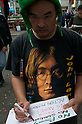 October 15, 2011, Tokyo, Japan - A protester prepares a banner before a demonstration in Shinjuku. ..Around 500 protesters took part in 3 separate protests in support of the Occupy Tokyo movement. The protesters airing a series of issues including Anti-Nuclear, Anti-Capitalism and Anti-TPP. They chanted '1% no thank you' and ' Nuclear no thank you ' at the rallies. Protesters in the Roppongi's Mikawadai Park numbered about 60 and were out numbered by around 70 Police and 40 members of the media. (Photo by Bruce Meyer-Kenny/AFLO) [3692]