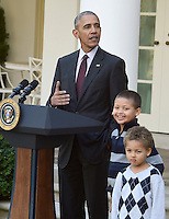 United States President Barack Obama, left, joined by nephews Austin Robinson, 6, center, and Aaron   Robinson, 4, right, pardons the 2016 National Thanksgiving Turkey, Tater, and its alternate Tot, during a ceremony in the Rose Garden of the White House in Washington, DC on Wednesday, November 23, 2016.  This is the 69th anniversary of this honored tradition began in 1947 by President Harry S Truman.  Once pardoned the birds will be sent to their new home at Virginia Tech&rsquo;s Animal and Poultry Sciences Department at &ldquo;Gobbler's Rest&rdquo; in Blacksburg, Virginia where they will be cared for by students and veterinarians.<br /> Credit: Ron Sachs / CNP /MediaPunch