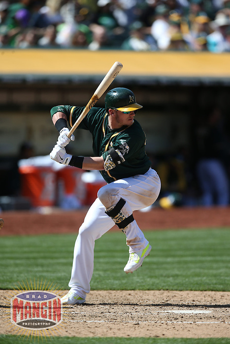 OAKLAND, CA - APRIL 19:  Josh Donaldson #20 of the Oakland Athletics bats against the Houston Astros during the game at O.co Coliseum on Saturday, April 19, 2014 in Oakland, California. Photo by Brad Mangin