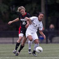 NC State midfielder Kristina Argiroff (15) encounters stiff defense from Boston College midfielder/defender Casey Morrison (3). Boston College defeated North Carolina State,1-0, on Newton Campus Field, on October 23, 2011.