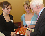 8/16/06 Council Bluffs. IA Sen. John McCain signs autographs for  Kolay Payne (center) and Mary Trecek (left) before attending  a breakfast for Iowa House of Representatives candidates Doug Struyk and Scott Belt at Iowa Community College. Payne is President and Trecek is Vice President of Student Government at IWCC..(Chris Machian/Prairie Pixel Group)