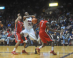 Ole Miss guard Zach Graham (32)  is defended by Georgia's Marcus Thornton (2) and Georgia's Travis Leslie (1) at the C.M. &quot;Tad&quot; Smith Coliseum in Oxford, Miss. on Saturday, January 15, 2011. Georgia won 98-76.  (AP Photo/Oxford Eagle, Bruce Newman)
