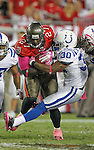 Indianapolis Colts strong safety David Caldwell (30) tries to bring down Tampa Bay Buccaneers running back LeGarrette Blount (27). The Buccaneers defeated the Colts 24-17 in an NFL game, Monday, Oct. 3, 2011 in Tampa, Fla. (AP Photo/Margaret Bowles)