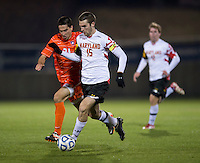 Ara Amirkhanian (21) of Clemson tries to keep up with Patrick Mullins (15) of Maryland during the game at the Maryland SoccerPlex in Germantown, MD. Maryland defeated Clemson, 1-0, in overtime.  With the win the Terrapins advanced to the finals of the ACC men's soccer tournament.