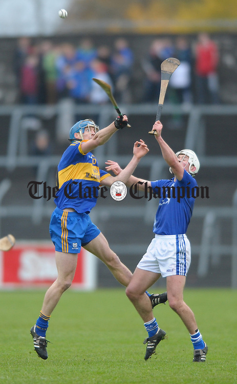 David Barrett of Newmarket On Fergus in action against Liam Markham of Cratloe during the senior county hurling final at Cusack Park. Photograph by John Kelly.