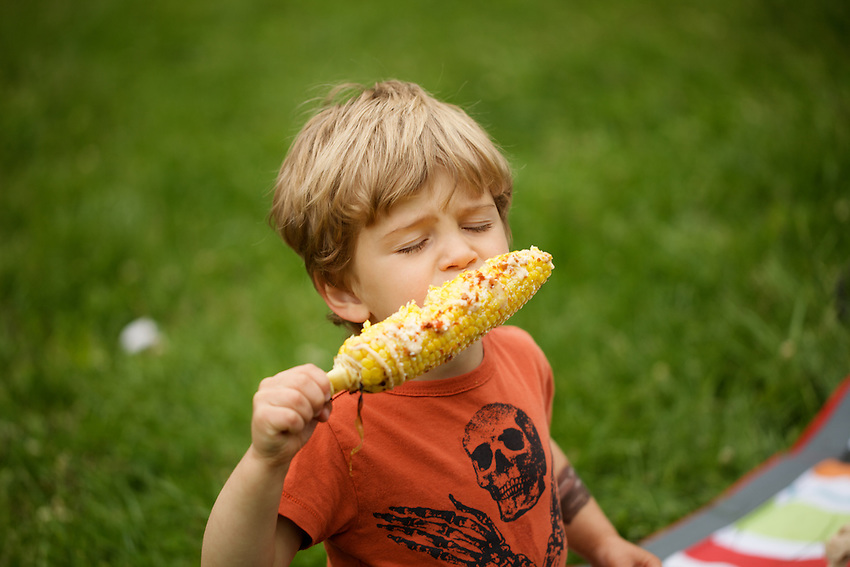 BROOKLYN, NY - MAY 18, 2013: A child enjoying corn on the cob at The Great Googa Mooga in Prospect Park. CREDIT: Clay Williams.<br /> <br /> <br /> &copy; Clay Williams / http://claywilliamsphoto.com