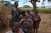 Yaeda Valley, Tanzania: Children in a settlement of Hadzabe hunter gatherers, one of the oldest tribes on earth. There are only 1500 Hadzabe left, all in this Northern Tanzania valley adjacent to the famed Serengeti Plains. The Hadzabe are currently on the verge of losing their hunting ground to a group of princes from the United Arab Emirates, who have struck a deal with the Tanzanian government to use the land as a safari playground. The Hadzabe oppose the deal.  (PHOTO: MIGUEL JUAREZ LUGO)