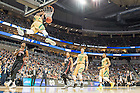 Mar. 19, 2015; Jerian Grant (22) dunks in the second half against Northeaster in the second round of the NCAA Tournament. Notre Dame won 69-65. (Photo by Matt Cashore/University of Notre Dame)