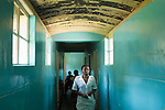 Zimbabwe, Mashonaland Central, Glendale area. December 04, 2006. A nurse walks down the hallway connecting the emergency and male wards at the Howard Hospital, Glendale, Zimbabwe.