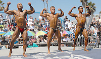 Representing the U.S. Navy, Rurman Reyes, 39; representing the U.S. Marines Misha Efremov, 24; and representing the U.S. Coast Guard Johnny Johnson, 25, pose-off during the Armed Forces Bodybuilding Championship / Muscle Beach International Classic on Monday, May 30, 2011. The Muscle Beach International Classic was presented by Joe Wheatley Productions.