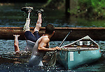 A competitor with prosthetic leg goes over the last hurdle as his partner awaits in an extreme canoe race in Florida.