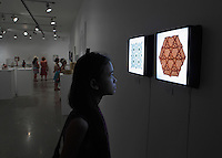 Surface to Structure origami exhibition at Cooper Union, New York. Gallery view. Back lit tessellations. Trillium Field Tessellation folded by Mimansa Vahia 2014 (front). Square Tessellation of Dodecagons #3 folded by Alessandro Beber 2012.
