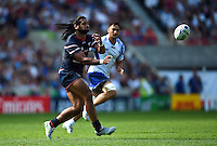 Andrew Durutalo of the USA passes the ball. Rugby World Cup Pool B match between Samoa and the USA on September 20, 2015 at the Brighton Community Stadium in Brighton, England. Photo by: Patrick Khachfe / Onside Images