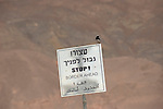 A bird on a stop-sign at Israel-Egypt border, where the new fence is still not complete.