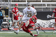 Towson, MD - March 25, 2017: Towson Tigers Joe Seider (26) hits Denver Pioneers Colin Squires (39) during game between Towson and Denver at  Minnegan Field at Johnny Unitas Stadium  in Towson, MD. March 25, 2017.  (Photo by Elliott Brown/Media Images International)