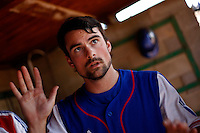 24 June 2011: Florian Peyrichou of Team France. Illustration of a photographic essay called Life in the dugout, during France 8-5 win over UCLA Alumni, at the 2011 Prague Baseball Week, in Prague, Czech Republic.