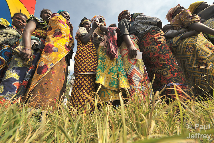 Women displaced by war in the eastern Congo line up to receive hygiene kits provided by the United Nations in a camp in the village of Sasha. A quarter of a million people have been newly displaced by fighting in the eastern Congo, where some 5.4 million have died since 1998 from war-related violence, hunger and disease.