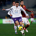 Calcio, Serie A: Roma vs Fiorentina. Roma, stadio Olimpico, 8 dicembre 2012..Fiorentina defender Manuel Pasqual is challenged by AS Roma forward Mattia Destro, right, during the Italian Serie A football match between AS Roma and Fiorentina at Rome's Olympic stadium, 8 december 2012..UPDATE IMAGES PRESS/Isabella Bonotto