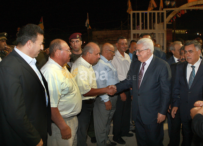 Palestinian President Mahmoud Abbas attends a mass wedding for 19 Groom in the village of Silwad in the West Bank city of Ramallah, June 28, 2012. Photo by Thaer Ganaim